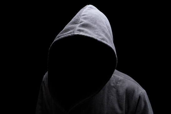 Hooded man in dark street - Self Defense is Essential